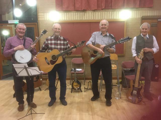 Folk music group performing at a fundraising event
