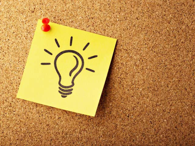 Post it note with drawing of a light bulb on it