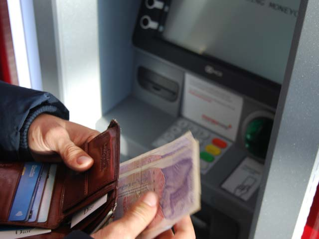 Person paying money into a bank