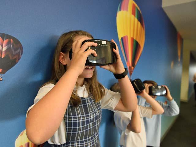 School children using VR headsets