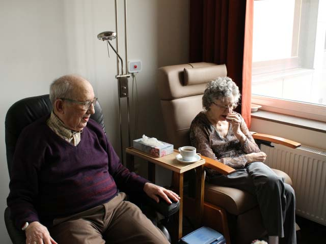 Two elderly people at home