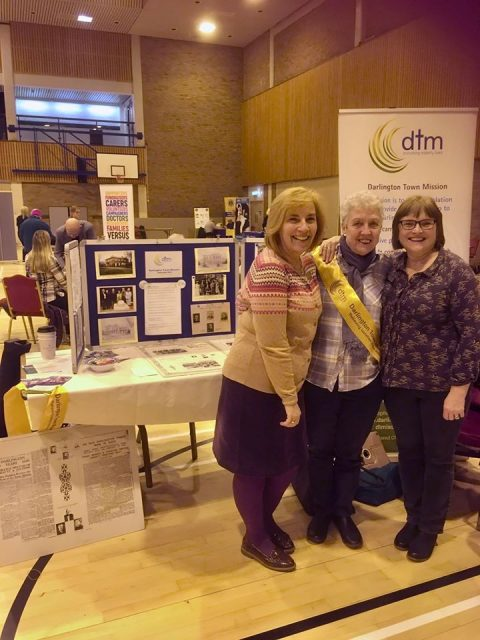Our assistant missioner, volunteer, and missioner attending the volunteers fair