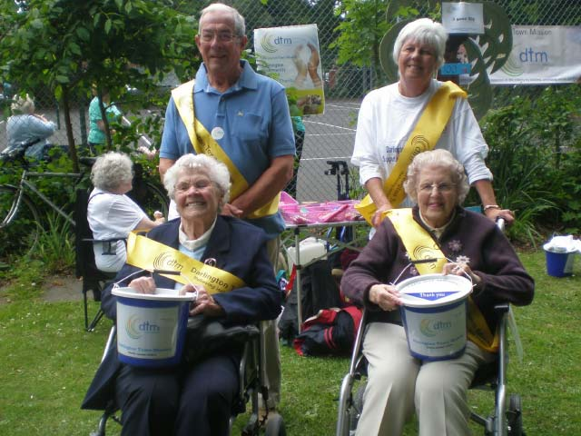Four darlington town mission volunteers with collection buckets